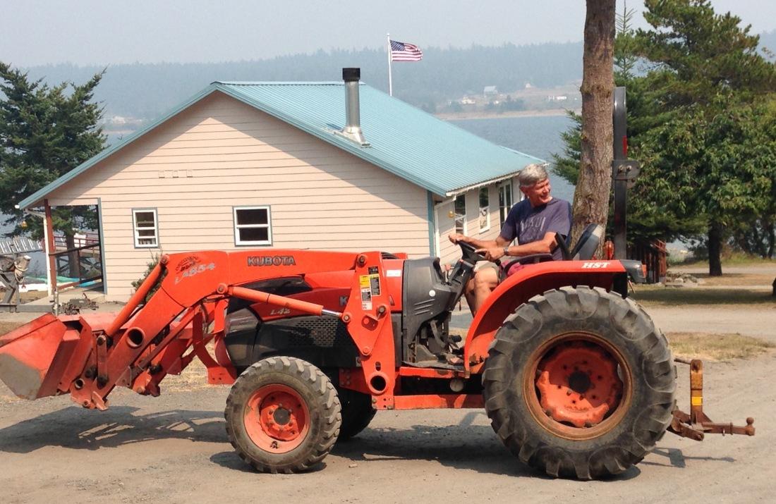 Brian drives tractor.jpg